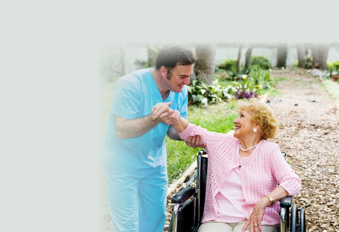 Beautiful disabled senior woman receiving physical therapy in an outdoor setting.