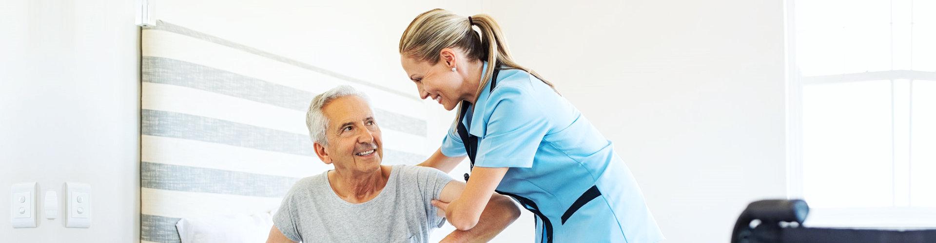 staff assisting elderly man