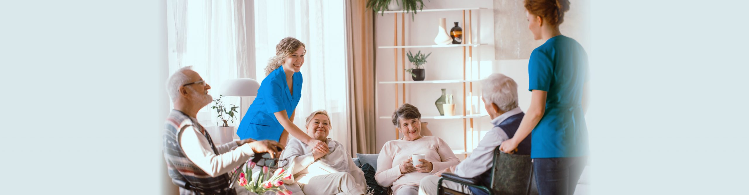 Disabled grandparents spending time in common room with their caregivers