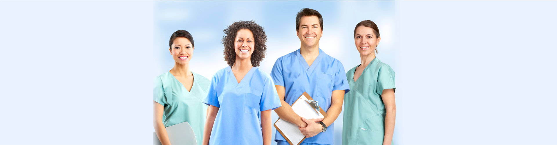 Hospital Staff Standing Outside A Hospital.
