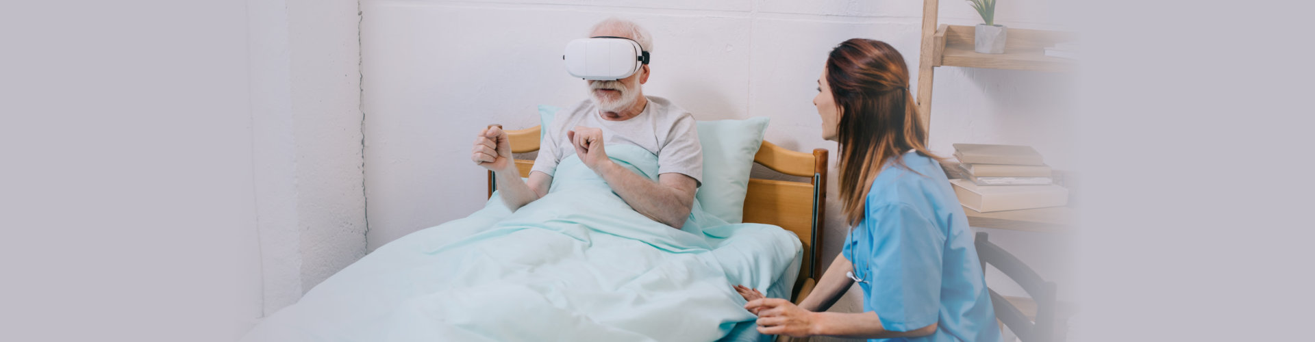Nurse sitting by old man.